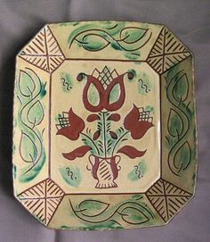 Very traditional Pennsylvania Dutch redware plate from Breininger Pottery in Robesonia, Pennsylvania, US Glazed Pottery, Glazes For Pottery, Ceramic Pottery, Old Crocks, Pennsylvania Dutch, Painted Plates, Primitive Antiques, Pottery Designs, Sgraffito