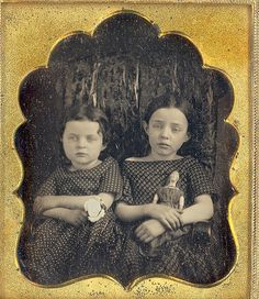 https://flic.kr/p/6m95Nx | Two girls with doll | 1/6 plate daguerreotype of two little girls posed on a large couch. One holds a flower and the other holds a doll. The girl holding the doll does not look like she feels well. The could be a pre-mortem.