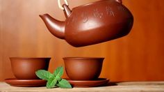 stock-footage-hot-tea-with-mint-leaf-pouring-into-a-cup.jpg (400×224)
