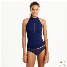J crew rash guard zip halter sz m nwt PRODUCT DETAILS Enjoy free shipping and free returns on our swim collection to the U.S. and Canada. If a halter-neck rash guard doesn't convince you to finally sign up for those surf lessons, we don't know what will.  Nylon/elastane. Hand wash. Import. Online only. Item C4859. SIZE & FIT DETAILS Hits above hip. Wear alone or over a bikini top. Black J. Crew Tops