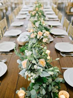 Table greenery garland with peach roses - Charming Southern Rustic Wedding from Amy Arrington Photography