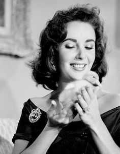 """maggiepollitts: """"  Elizabeth Taylor plays with a duckling at home, 1957. """""""