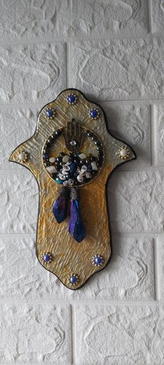 Unique Hamsa, one of a kind. Made of wood and painted with gold and silver acrylic paint. Decorated with beads and charms. Hamsa Art, Hamsa Design, Good Luck Symbols, Good Luck To You, Silver Paint, Blue Beads, Jewelry Stores, Charms, Wall Decor