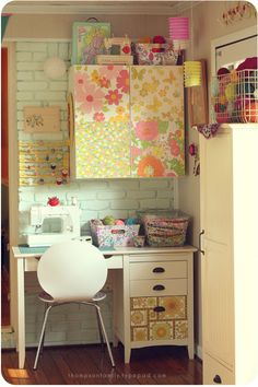 A sewing space small, but cute, tucking in somewhere, but not shut off from the family.