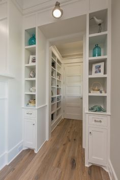 Living Room Built In Bookcase Nook. Living room features a nook with built in bookcases painted in Sherwin Extra White. Living Room Built In…