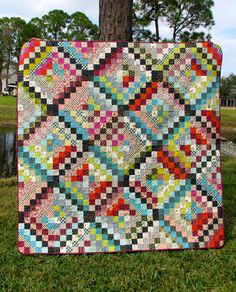 scrappy trip around the world quilt from Blossom Heart Quilts