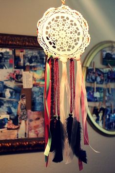 DREAMCATCHER DIY Simple: -Doily -Wire -Thrifted Ribbons -Yarn -Beads - Craft Feathers (Use real ones if you got em)
