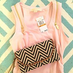 """Michael Kors Blush Top This is a beauty. Color is blush - MK calls this """"blossom"""". Rouched on the sides so it has the ability to pull your waist in and is very flattering. The zippers call for an edge and classy sex appeal. NWT. Reasonably negotiable through the offer button only. Michael Kors Tops Tank Tops"""