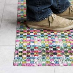 """Cool area rug made of recycled measuring tape-- from a blog called """"Hipster Decorating"""" haha."""