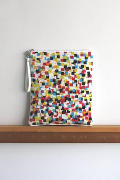 needlepoint zipper clutch / COLOR. $100.00, via Etsy.