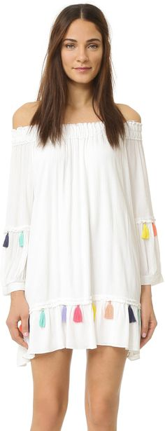 Cute white mini dress with tassel detail and off the shoulder neckline. MISA Camilla Dress