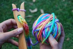 wooden knitting fork with hand painted rainbow wool. $23.50