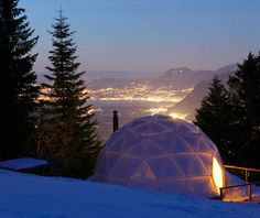 The Whitepod Resort is located Les Cerniers, Switzerland in the heart of the Alps. It features an authentic mountain lodge and traditional wooden chalet both with restaurants, 7 km of ski slopes with private ski lifts, and the pièce de résistance — Whitepod — a camp of 15 geodesic dome pods surrounding a central chalet.