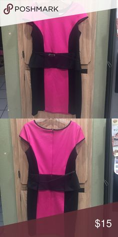 Peplum black and pink dress Super cute black and hot pink peplum dress. It is super flattering and the material is really comfortable! Stretches a little to make fit comfortable. Comes with a belt Liz Claiborne Dresses