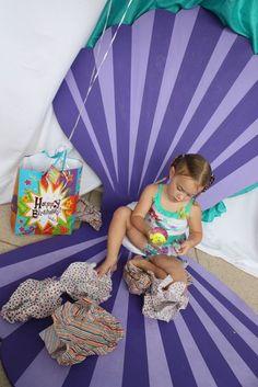 The Little Mermaid Birthday Party Ideas | Cute shell photo booth backdrop