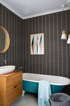 Bathroom feature wall with Orla Kiely wallpaper