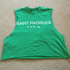St. Patrick's Paris Tshirt by the Laundry Room Ca. Green distressed tank top by The Laundry Room of Ca. With St . Patrick's Paris on front . One size fits all . Sleeveless all holes /rips/tears are part of the original design The Laundry Room of Ca Tops Tees - Short Sleeve