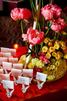 Escort cards were displayed in crystal-embellished card holders shaped like butterflies. #seatingcards #escortcards #butterflies Photography: Davina + Daniel. Read More: http://www.insideweddings.com/weddings/vibrantly-colored-indian-wedding-in-new-orleans-lousiana/579/