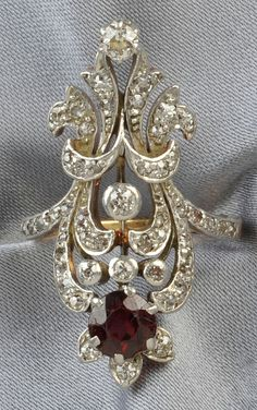 Edwardian Garnet and Diamond Ring, set with a later circular-cut garnet, further set with old mine-cut diamonds, platinum-topped 18kt gold mount,