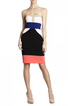 $175.00 Frame a flattering look in this boldly color-blocked dress. Straight neck. Strapless.Color-blocked pattern. Contrast banded waist.Center back zipper with hook-and-eye closure.Crepe: Polyester.Dry Clean.Imported.