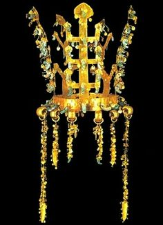 """The finest (Korean) Silla gold were golden crowns, discovered in the Royal tombs near the ancient capital of Kyongju. Discovered at Hwang-nam, this one of 10 pure gold crowns survive from from ancient times. The crown is shaped like a tree branch or antler, a Korean reference to nature, trees as intermediaries between earth & heaven, with roots spread into the earth & branches stretched skyward. The antler represents reindeer, also known as """"the gentleman of the forest"""", a symbol of…"""
