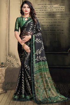 Black chiffon saree with green satin blouse. Embellished with resham work embroidery. Saree with ,Key Hole Neck, Half Sleeve. It comes with unstitched blouse. Chiffon Saree, Silk Sarees, Black Saree, Stylish Sarees, Casual Saree, Latest Sarees, Traditional Sarees, Green Satin, Sherwani