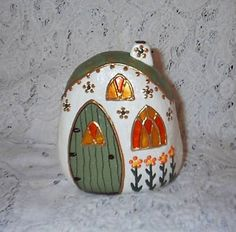My painted river rock fairy houses sold very well a few years ago on eBay. Now I wish I would have kept a few for myself. All I have is these pictures and fond memories of rock hunting at the river with my doggy ...