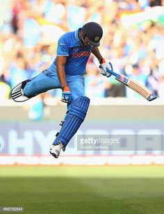 Rohit Sharma of India celebrates after scoring his century during the 2015 ICC Cricket World Cup match between India and Bangldesh at Melbourne Cricket Ground on March 2015 in Melbourne,. Get premium, high resolution news photos at Getty Images Icc Cricket, Cricket Sport, Cricket Match, First World Cup, India Cricket Team, Cricket Wallpapers, World Cup Match, Hard Working Man, International Teams