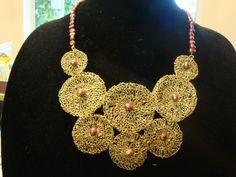Unique Hand made  Gold wire crochet and berry fresh water pearls necklace. $85.00, via Etsy.