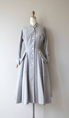 Vintage 1950s deadstock with tags pale grey gabardine wool coat with fatastic extending rows of buttons, dolman and cuffed sleeves, fitted waist, oversized hip pockets and full skirt. White satin lining.  --- M E A S U R E M E N T S ---  fits like: medium shoulder: n/a, no seam bust: up to 38 waist: 28 or under hip: free sleeve: approx. 18.5 length: 48.5 brand/maker: Bests Apparel | Seattle condition: excellent  ★ layaway is available for this item  ➸ More vintage coats http:/&...