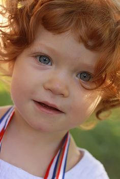 Curly red hair child...what a cutie