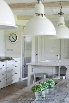 Stunning white farmhouse kitchen with big industrial pendants