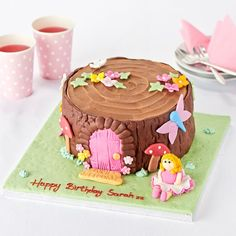This woodland fairy cake incorporates the woodland theme through the tree trunk fairy house, whilst adding a girly twist with the butterfly and flower accents as well as the fairy model. This cake can be personalise with a message of up to 35 characters long, to make the birthday girl feel extra special on her big day.