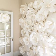 This tutorial teaches you how to make stunning diy giant paper flowers: the perfect backdrop for a wedding, nursery, girl's room, or any elegant space.
