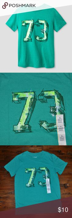 New CAT & JACK Boys 73 Graphic Short Sleeve Tee available in size XS (4/5) | S (6/7) | XL (16) new without tags color: green  graphic t-shirt  @cjrose25  More kids clothes in my posh closet. Bundle your likes for a discount & save on shipping. Cat & Jack Shirts & Tops Tees - Short Sleeve