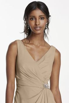Alluring yet classic, this crepe cowl back dress is one your bridesmaids will want to wear again! Tank V-neck bodice features ruching at the back and the side, accented with a crystal brooch for some extra sparkle. Cowl back detail and a side slit skirt take this dress to the next level. Fully lined. Imported polyester. Back zipper. Dry clean only.