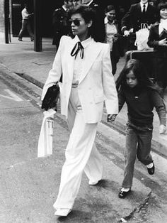 Bianca Jagger sure knew how to rock the pant suit look