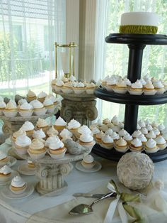 Vanilla infused cupcakes with whipped cream icing in tones of ivory and white.