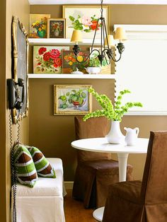 Vintage or rustic artwork from thrift shops and flea markets adds interest to a room.