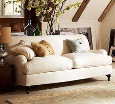 Carlisle Slipcovered Apartment Sofa | Pottery Barn - Slipcover for kids and pets. Apartment sized for rental living.