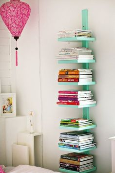 Book Tower for Book Organization. Would also be great in a living room or even the kitchen for recipe books!