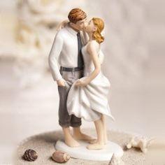 La figurine baiser sur la plage