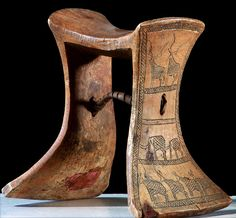 Africa   Headrest from the Karamojong / Karamajong people of Uganda in eastern Africa   Wood, leather. With incised designs of animals on each side   Mid 20th century