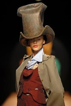 Vivienne Westwood - mad hatter from alice in wonderland. The top hat makes you know which character it is. Also the waist coat and smart clothing draws attention to the overall look because it looks quite smart when the mad hatter is mad.
