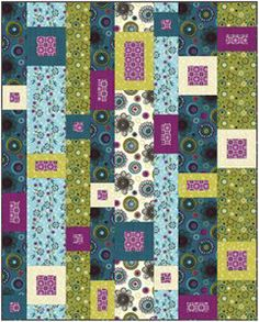 Modern quilt called Cityscapes, a free pattern from Studio Fabrics.
