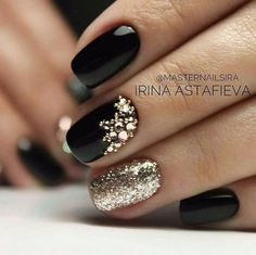 Black nail polish with gold glitter art accents. Gorgeous for formal or evening events.   Ledyz Fashions    www.ledyzfashions.com