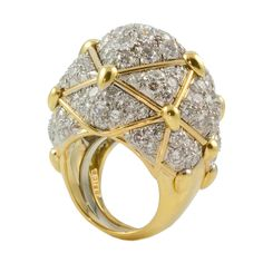 """POW! This David Webb ring is sure to stun onlookers and make a bold fashion statement."" 18kt Yellow Gold, Platinum and Diamonds, $62,000; available at David Webb, New York 212-421-3030, 942 Madison Avenue, New York and David Webb, Beverly Hills 310-858-8006."