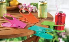 4 Colorful Clip On Table Cup Holders by Winston Brands - - Product Description: Short on table space? These drink clips let diners clip their beverage to the side of the table. Holds all standard Cool Desk Gadgets, Clever Gadgets, Drink Holder, Cup Holders, Collections Etc, Tropical Colors, Outdoor Fun, Outdoor Ideas, Coffee Cups