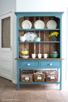 I need to find a hutch like this for our kitchen.  It would be perfect for displaying our pottery!