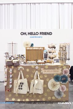 trade show booth.   diy craft paper spraypainted polka dots